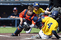 Illinois Fighting Illini catcher Mark Skonieczny (25) tags Michigan Wolverines baserunner Ako Thomas (4) out at the the plate during the NCAA baseball game on April 8, 2017 at Ray Fisher Stadium in Ann Arbor, Michigan. Michigan defeated Illinois 7-0. (Andrew Woolley/Four Seam Images)