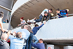 © Joel Goodman - 07973 332324 . 13/05/2012 .  Manchester , UK . Manchester City Football Club fans celebrate and climb over barriers to enter the Etihad Stadium after the result of their match against QPR ensures Manchester City wins the Premiership title . Photo credit: Joel Goodman