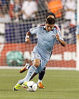 Sporting Kansas City substitute forward Soony Saad (22) brings the ball forward as New England Revolution midfielder Lee Nguyen (24) closes rapidly. In a Major League Soccer (MLS) match, Sporting Kansas City defeated the New England Revolution, 1-0, at Gillette Stadium on August 4, 2012.