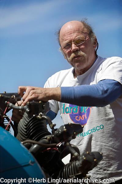 "Pilot and mechanic Durward ""Chips"" Armstrong checks out a Lycoming radial engine on a Stearman at the  Petaluma Municipal Airport, Petaluma, Sonoma County, California"