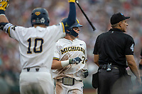 Michigan Wolverines outfielder Jesse Franklin (7) scores a run during Game 1 of the NCAA College World Series against the Texas Tech Red Raiders on June 15, 2019 at TD Ameritrade Park in Omaha, Nebraska. Michigan defeated Texas Tech 5-3. (Andrew Woolley/Four Seam Images)