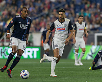 Foxborough, Massachusetts - August 11, 2018: First half action. In a Major League Soccer (MLS) match, New England Revolution (blue/white) vs Philadelphia Union (white), at Gillette Stadium.