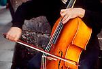 Spain, Barcelona, A musician playing the cello on the La Rambala, Europe,.