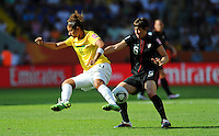 Amy Le Peilbet (r) of team USA and Cristiane of team Brazil during the FIFA Women's World Cup at the FIFA Stadium in Dresden, Germany on July 10th, 2011.