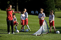USWNT defender Rachel Buehler explains a drill during a Lets Move! soccer clinic held on the South Lawn of the White House.  Let's Move! was started by Mrs. Obama as a way to promote a healthier lifestyle in children across the country.