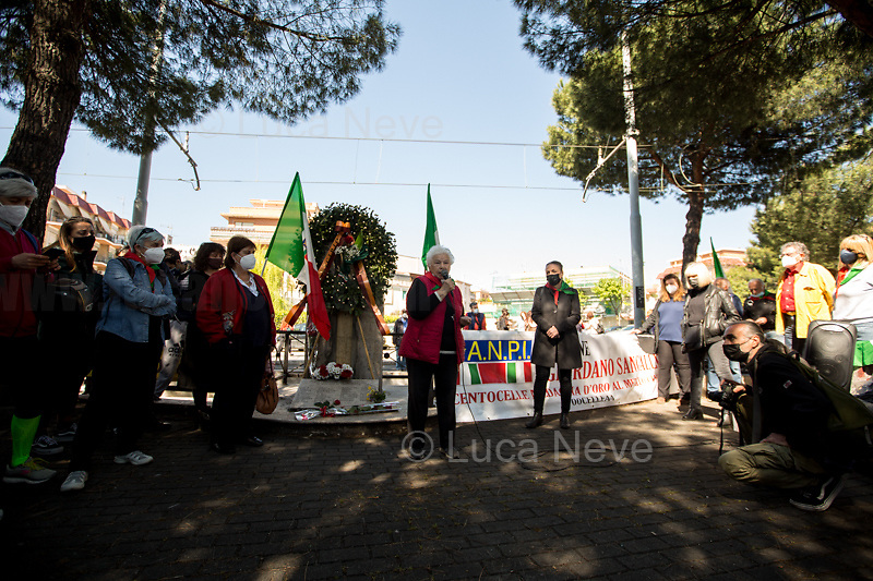 Pina Renzi, daughter of Paolo Renzi, WWII Italian Partizans, Member of the Italian Resistance.<br /> <br /> Rome, Italy. 25th Apr, 2021. Today, to mark the 76th Anniversary of the Italian Liberation from nazi-fascism (Liberazione), Azione Antifascista Roma Est, supported by ANPI Centocelle (National Association of Italian WWII Partizans), and various Antifascist organizations, movements, students, political parties, social centres, held a march (Corteo) from Piazza delle Camelie to Villa Gordiani's Park (1.), in Centocelle's district. The demonstration began with a rally in front of the Memorial dedicated to the Partizans of Centocelle victims of nazi-fascist occupation troops and retaliations, where Partizans and their relatives, activists, historians gave speeches to remember the population struggle and solidarity, to keep the memory and the lesson of the Resistenza alive and to reaffirm the values of Freedom and Justice of the Italian Antifascist Constitution as the only way to fight against fascist pulsions re-appearing all over the world.  <br /> On the 4th June 2018 the Centocelle's District was awarded of the State Gold Medal (for Civil Merit) for its Antifascist Resistance (2.).<br /> <br /> Footnotes & Links: <br /> 1. http://bit.do/fQB69 <br /> 2. http://bit.do/fQB7m <br /> Previous 25 Aprile's Events:<br /> - 25 Aprile 2020: http://bit.do/fQB77 <br /> - I Partigiani http://tiny.cc/cwi3nz<br /> - 25 Aprile 2019 (at Ferramonti di Tarsia concentration camp) http://bit.do/fQB8i <br /> - 25 Aprile 2018 http://tiny.cc/dsi3nz<br /> http://www.anpi.it <br /> (Source, Wikipedia.org ENG) The Liberazione: https://en.wikipedia.org/wiki/Liberation_Day_(Italy)