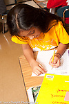 Education Elementary Grade 3 math activity girl at work
