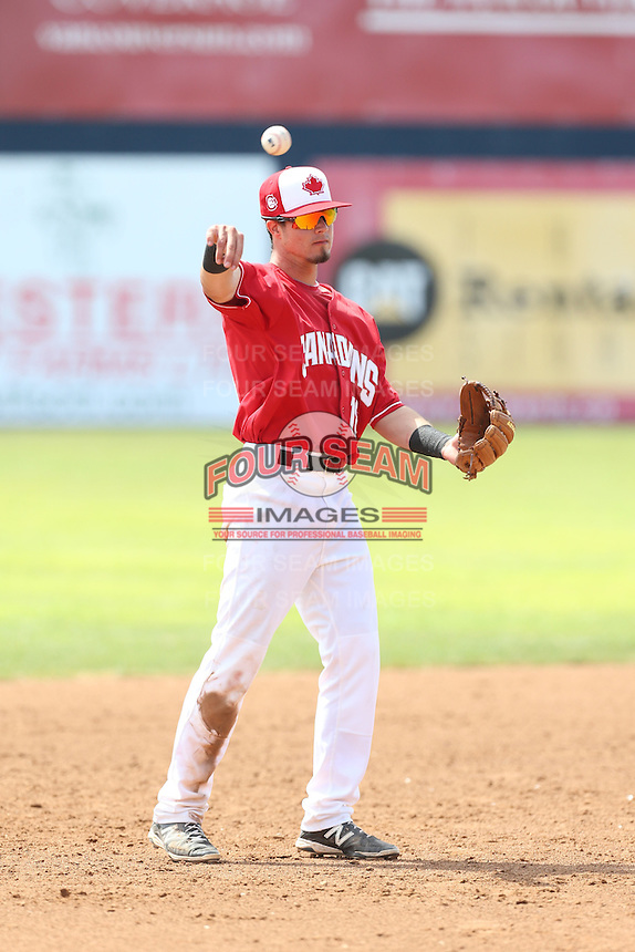 J.C. Cardenas (18) of the Vancouver Canadians makes a throw during a game against the Eugene Emeralds at Nat Bailey Stadium on July 22, 2015 in Vancouver, British Columbia. Vancouver defeated Eugene, 4-2. (Larry Goren/Four Seam Images)