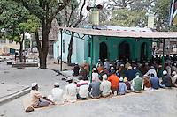 Men Awaiting Prayer Time, Madrasa Imdadul Uloom, Dehradun, India.