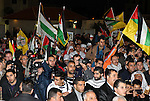 Palestinians wave their national flag during a rally on the eve of the 48th anniversary of the formation on the Fatah movement, on December 31, 2012, in the West Bank city of Ramallah. The Fatah anniversary commemorates the first operation against Israel claimed by its armed wing then known as Al-Assifa (The Thunderstorm in Arabic) on January 1, 1965. Photo by Thaer Ganaim