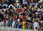 The crowd from the Preakness Village gathers along the infield fence to watch the Preakness Stakes at Pimlico Race Course on May 19, 2012