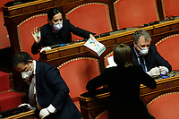 A senator offers gloves to a colleague<br /> Rome March 26th 2020. Senate. Information of the Italian Premier about the measures adopted to contrast Coronavirus, Covid-19.<br /> Photo Samantha Zucchi Insidefoto
