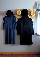 Still life of several coats and hats hanging on a wall. Strasburg Pennsylvania USA Lancaster County.
