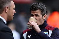 Lee Trundle of Swansea talks with Joey Barton of  Burnley ahead of the Premier League match between Swansea City and Burnley at The Liberty Stadium, Swansea, Wales, UK. Saturday 06 March 2017