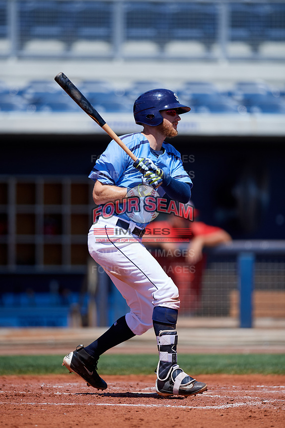 Charlotte Stone Crabs first baseman Dalton Kelly (7) follows through on a swing during a game against the Palm Beach Cardinals on April 12, 2017 at Charlotte Sports Park in Port Charlotte, Florida.  Palm Beach defeated Charlotte 8-7.  (Mike Janes/Four Seam Images)
