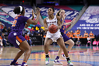 GREENSBORO, NC - MARCH 6: Taylor Soule #13 of Boston College is guarded by Chyna Cotton #32 and Kendall Spray #3 of Clemson University during a game between Clemson and Boston College at Greensboro Coliseum on March 6, 2020 in Greensboro, North Carolina.