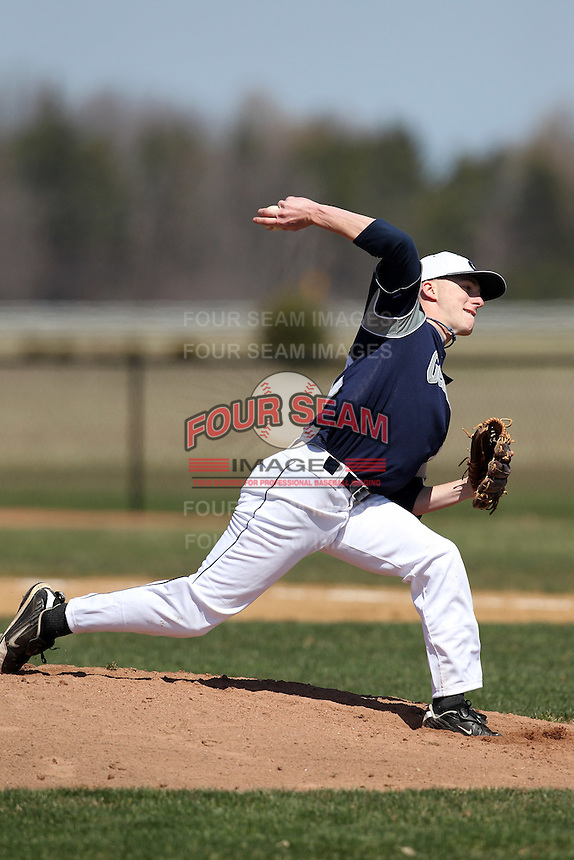 Genesee Community College Cougars pitcher Daniel Sharpe #42 delivers a pitch during a game against the Ithaca JV team at Genesee Community College on April 9, 2011 in Batavia, New York.  Photo By Mike Janes/Four Seam Images