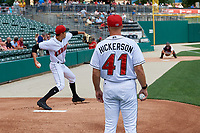 Indianapolis Indians coach Bryan Hickerson (41) watches starting pitcher Eduardo Vera (7) warmup in the bullpen before an International League game against the Syracuse Mets on July 17, 2019 at Victory Field in Indianapolis, Indiana.  Syracuse defeated Indianapolis 15-5  (Mike Janes/Four Seam Images)