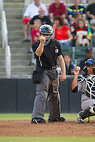 Home plate umpire Randy Rosenberg makes a strike call during the South Atlantic League game between the Asheville Tourists and the Kannapolis Intimidators at CMC-NorthEast Stadium on July 12, 2014 in Kannapolis, North Carolina.  The Tourists defeated the Intimidators 7-5 in 15 innings.  (Brian Westerholt/Four Seam Images)