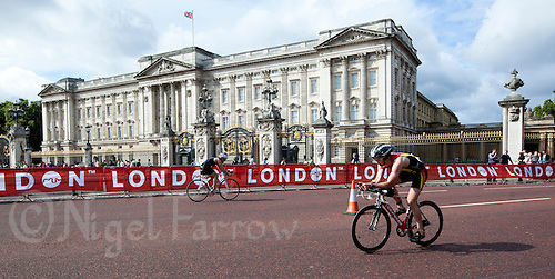 07 AUG 2011 - LONDON, GBR - Competitors cycle past Buckingham Palace during the age group Olympic distance race at triathlon's ITU World Championship Series event (PHOTO (C) NIGEL FARROW)