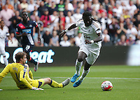 Pictured: Bafetimbi Gomis of Swansea gets past Newcastle goalkeeper Tim Krul (L) to open the score, making it 1-0 to his team Saturday 15 August 2015<br /> Re: Premier League, Swansea City v Newcastle United at the Liberty Stadium, Swansea, UK.