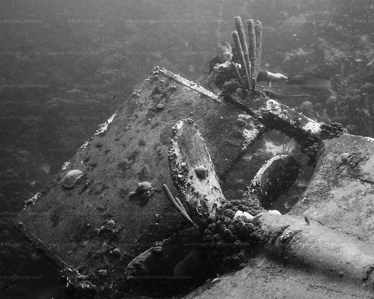 """Diving Bonaire, Netherland Antilles -- A diver takes pictures at the propeller of the """"Hilma Hooker.""""  (""""Hilma Hooker"""" dive site)."""