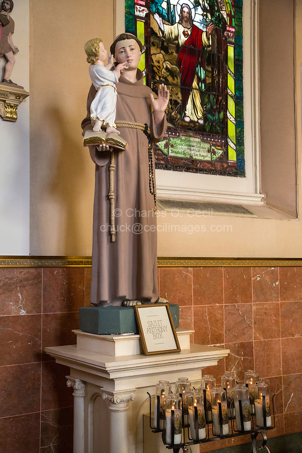 French Quarter, New Orleans, Louisiana.  Statue to St. Anthony in St. Mary's Catholic Church, Chartres Street.