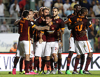 Calcio, Serie A: Frosinone vs Roma. Frosinone, stadio Comunale, 12 settembre 2015.<br /> Roma's Juan Iturbe, left, celebrates with teammates after scoring during the Italian Serie A football match between Frosinone and Roma at Frosinone Comunale stadium, 12 September 2015. Roma won 2-0.<br /> UPDATE IMAGES PRESS/Isabella Bonotto