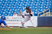 Lake County Captains first baseman Jose Vicente (15) stretches to receive a pick off throw as Brandon Hughes (11) dives back towards the base during the first game of a doubleheader against the South Bend Cubs on May 16, 2018 at Classic Park in Eastlake, Ohio.  South Bend defeated Lake County 6-4 in twelve innings.  (Mike Janes/Four Seam Images)