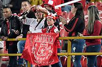 BOGOTA - COLOMBIA - 26 - 01 - 2018: Hinchas de America de Cali, animan a su equipo, durante partido entre Independiente Santa Fe y America de Cali, por el Torneo Fox Sports 2018, jugado en el estadio Nemesio Camacho El Campin de la ciudad de Bogota. / Fans of America de Cali, cheer for their team during a match between Independiente Santa Fe y America de Cali, for the Fox Sports Tournament 2018, played at the Nemesio Camacho El Campin stadium in the city of Bogota. Photo: VizzorImage / Luis Ramirez / Staff.