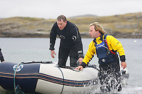 Saturday Oct 10 2009.  SCUBADIVE WEST, GALWAY, IRELAND:  Paul Devane arrives on shore after technical difficulties forced him from the water during the sixth hour of his world record attempt with his brother Declan to be the first divers to stay underwater on SCUBA for a period of 24-hours.