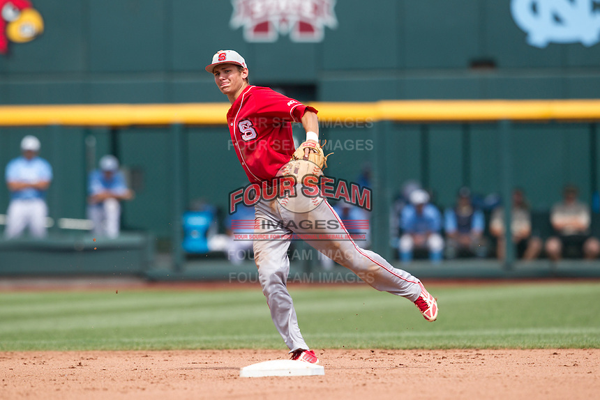 North Carolina State Wolfpack shortstop Trea Turner #8 throws during Game 3 of the 2013 Men's College World Series between the North Carolina State Wolfpack and North Carolina Tar Heels at TD Ameritrade Park on June 16, 2013 in Omaha, Nebraska. The Wolfpack defeated the Tar Heels 8-1. (Brace Hemmelgarn/Four Seam Images)