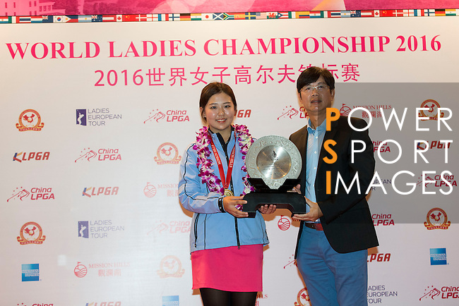 Jin Man of China receives the Leading Amateur Trophy during the Prize giving ceremony of the World Ladies Championship 2016 on 13 March 2016 at Mission Hills Olazabal Golf Course in Dongguan, China. Photo by Victor Fraile / Power Sport Images