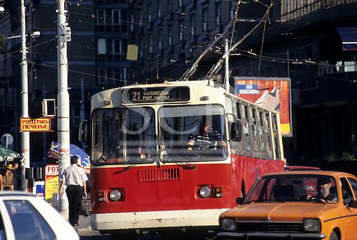 Belgrade, Serbia, Yugoslavia. Traffic; people using public transport; trolleybus; cars.