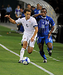 08 July 09: Steve Cherundolo (US) fights past Honduras' Carlos Palacios during their match at the CONCACAF Gold Cup at RFK Stadium in Washington, DC.