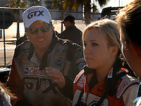"Jan 20, 2007; Las Vegas, NV, USA; NHRA Super Comp driver Brittany Force receives instructions from her father John Force during preseason testing at ""The Strip"" at Las Vegas Motor Speedway in Las Vegas, NV. Mandatory Credit: Mark J. Rebilas"