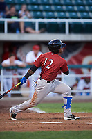 Idaho Falls Chukars Juan Carlos Negret (12) follows through on his swing during a Pioneer League game against the Orem Owlz at The Home of the OWLZ on August 13, 2019 in Orem, Utah. Orem defeated Idaho Falls 3-1. (Zachary Lucy/Four Seam Images)