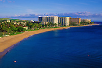 Visitors enjoy Kaanapali Beach in late afternoon in Kaanapali. Kaanapali was the first planned resort in the Hawaiian Islands. The famous Black Rock snorkeling area is in the foreground.