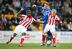 St Johnstone v Rangers....05.04.11 .Steven Naismith and Maurice Edu battle with Jordan Robertson.Picture by Graeme Hart..Copyright Perthshire Picture Agency.Tel: 01738 623350  Mobile: 07990 594431