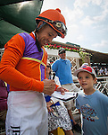 September 27 2014: Mike Smith signs an autograph for a young fan at Santa Anita Park in Arcadia CA. Alex Evers/ESW/CSM
