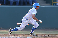 Brian Carroll #24 of the UCLA Bruins bats against the Cal Poly Mustangs at Jackie Robinson Stadium on February 22, 2014 in Los Angeles, California. Cal Poly defeated UCLA, 8-0. (Larry Goren/Four Seam Images)