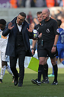 (L-R) Swansea manager Carlos Carvalhal protests to referee Lee Mason during the Premier League match between Swansea City and Everton at The Liberty Stadium, Swansea, Wales, UK. Saturday 14 April 2018