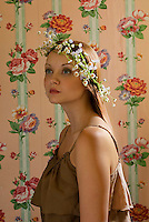 Young woman with wild flowers in her hair