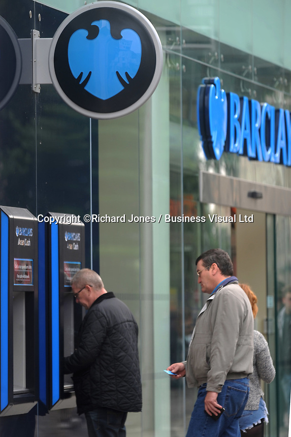 Barclays Bank customers withdraw cash in Cardiff.      29-Sept-2013