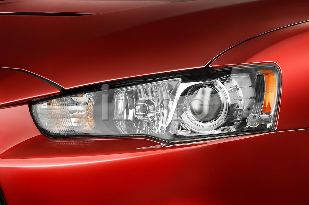 Closeup detail view of a head light on a 2008 Mitsubishi Lancer Evolution