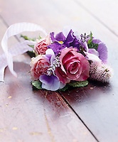 Detail of a pretty posy of roses, pansies and lavender