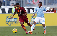 Calcio, Serie A: Lazio vs Roma. Roma, stadio Olimpico, 9 febbraio 2014.<br /> AS Roma midfielder Michel Bastos, of Brazil, is challenged by Lazio midfielder Ogenyi Onazi, of Nigeria, right, during the Italian Serie A football match between Lazio and AS Roma at Rome's Olympic stadium, 9 February 2014.<br /> UPDATE IMAGES PRESS/Riccardo De Luca