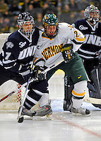 1 February 2008: University of Vermont Catamounts' forward Jack Downing, a Freshman from New Canaan, CT, battles University of New Hampshire Wildcats' defenseman Joe Charlebois, a Junior from Potsdam, NY, in front of the net at Gutterson Fieldhouse in Burlington, Vermont. The seventh-ranked Wildcats defeated the Catamounts 5-1in front of a sellout crowd of 4,003...Mandatory Photo Credit: Ed Wolfstein Photo