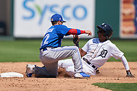 Toronto Blue Jays Rafael Lantigua (52) tags Jose King (17) sliding into second base during a Minor League Spring Training game against the Detroit Tigers on April 22, 2021 at Joker Marchant Stadium in Lakeland, Florida.  (Mike Janes/Four Seam Images)