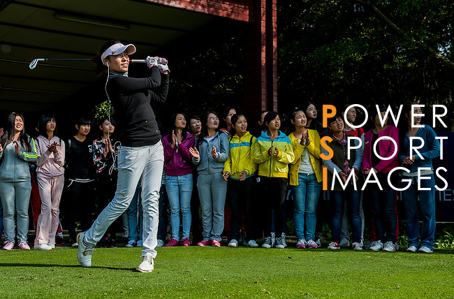 Vice Chairman of Mission Hills Group Tenniel Chu attends a Clinic with players during the Hyundai China Ladies Open 2014 at World Cup Course in Mission Hills Shenzhen on December 13 2014, in Shenzhen, China. Photo by Xaume Olleros / Power Sport Images